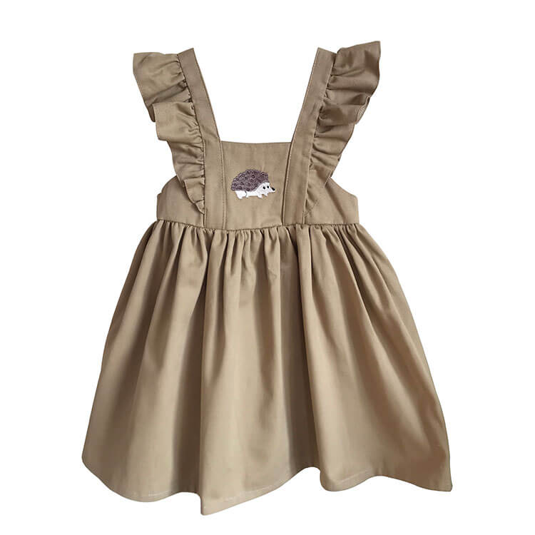 Kirpi desenli bej bebek elbisesi